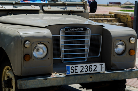 TORRE DEL MAR, SPAIN - JUNE 3, 2018 Old antique cars issued for tourists visiting a seaside town in Spain
