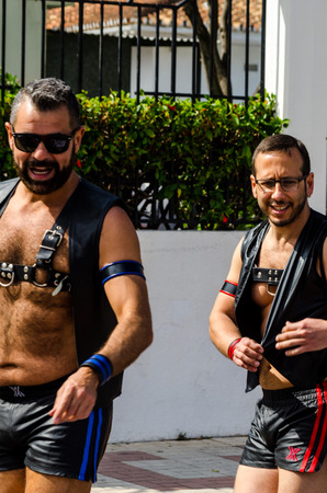 TORREMOLINOS, SPAIN - JUNE 2, 2018 LGBT march promoting equality and tolerance in a coastal town in Andalucia