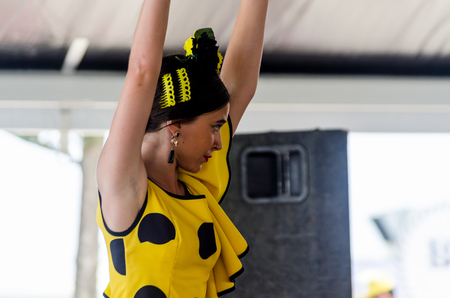 TORRE DEL MAR, SPAIN - JULY 22, 2018 show of Latin dance performed by a dance group in the rhythm of Spanish music, youth in folk costumes performing in front of the audience, dance show Editorial