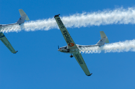 TORRE DEL MAR, SPAIN - JULY 29, 2018 planes flying over the beach in a seaside town, aerobatics airshow in Andalusia