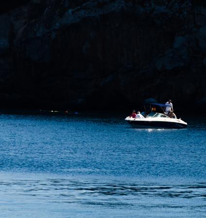 LA HERRADURA, SPAIN - MAY 26, 2018 A beautiful bay with people on the luxury yachts and motor boats in the tourist seaside town of La Herradura Editorial