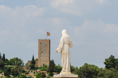 White statue of Jesus on the hill, place of prayers outside, Christianity