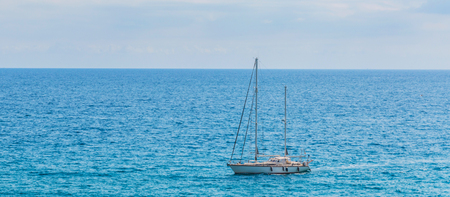 Yacht sailing the sea, clear sky and blue water, recreational sport, active rest 写真素材