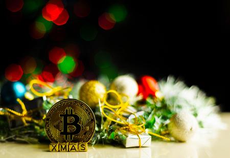 Crypto currency Gold Bitcoin, BTC, macro shot of Bitcoin coins on christmas background,  bitcoin mining concept