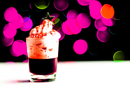Christmas drink shot in a shot glass on a bokeh background, Christmas decoration on the bar, xmas party