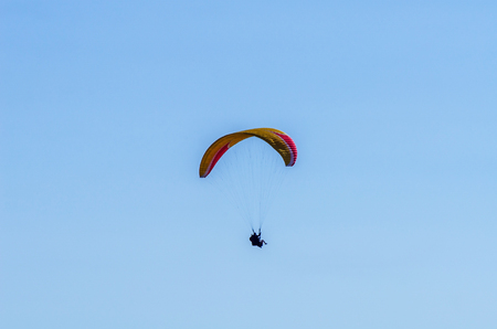 Paraglider flying in the sky free time spent actively wonderful experiences vacation, active sport