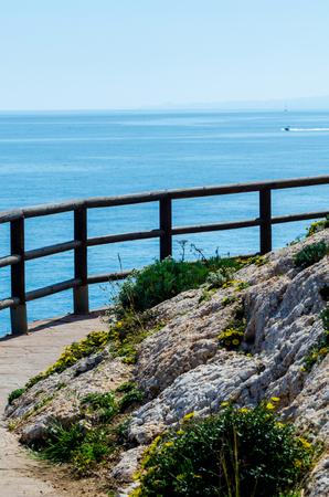 Wooden promenade along the sea coast situated on a cliff rock in Rincon de la Victoria, Costa del Sol, Andalusia, Spain
