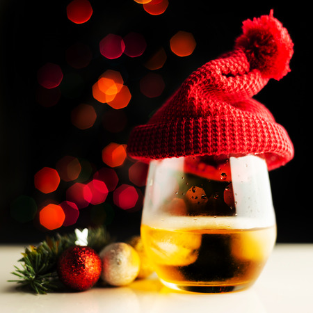 Single malt  whisky in tasting glass on Christmas background, colorful bokeh, xmas time