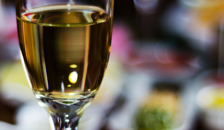 Champagne with set appetizers in small portions, healthy and delicious snacks, tasty set on blurred background.