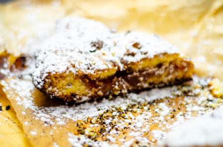 Closeup on a crumb cake stuffed with strawberry marmalade, delicious dessert