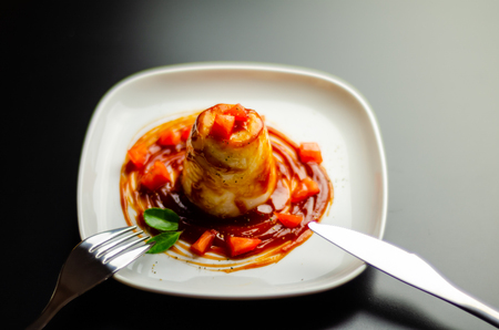A closeup on a rice dish and a tomato-based sauce, an elegant portion of food, a vegetarian meal