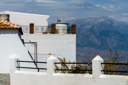 Typical white defensive walls in a small town of Andalusia, a historic element of architecture, Spain