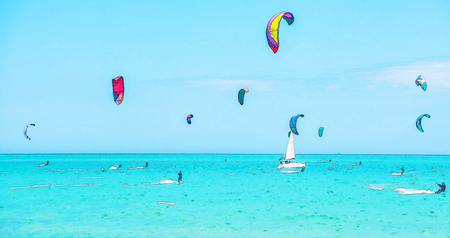 Kitesurfing on the waves of the sea in Spain, watercolor painted, active sport