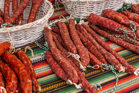Traditional Spanish sausages arranged at the stand, bazaar with food 写真素材