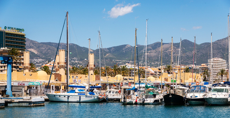 FUENGIROLA, SPAIN - APRIL 28, 2018 A beautiful marina with luxury yachts and motor boats in the tourist seaside town of Fuengirola