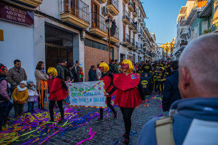 VELEZ-MALAGA, SPAIN - FEBRUARY 3, 2018 A colorful carnival parade organized by the inhabitants of a small town in Andalusia