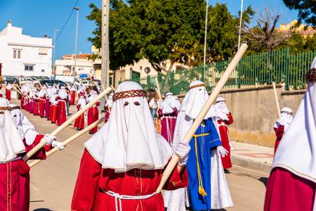 VELEZ-MALAGA, SPAIN - MARCH 27, 2018 People participating in the procession  in the Holy Week in a Spanish city, easter Redakční