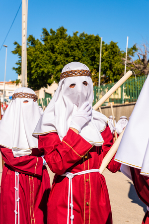 VELEZ-MALAGA, SPAIN - MARCH 27, 2018 People participating in the procession  in the Holy Week in a Spanish city, easter Editorial