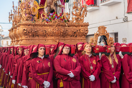 VELEZ-MALAGA, SPAIN - MARCH 25, 2018 People participating in the procession connected in a holy week in a Spanish city, easter