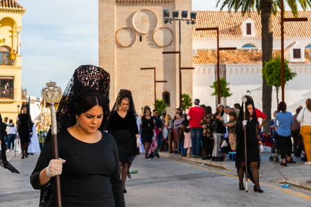 VELEZ-MALAGA, SPAIN - MARCH 29, 2018 People participating in the procession  in the Holy Week in a Spanish city, easter