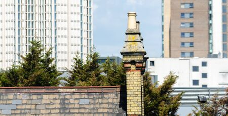 Typical English chimneys on the roofs of London buildings, an element of architecture