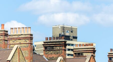 Typical English chimneys on the roofs of London buildings, an element of architecture Foto de archivo