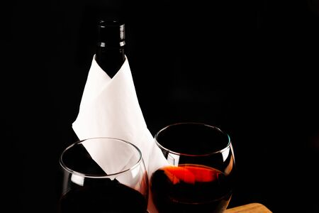 Red wine in a wine glass with a bottle of wine, celebration of a moment with a glass of wine, exquisite liquor for gourmets, winery