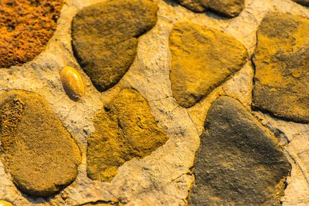 old stone placed in the wall, interesting and original background, solid wall Stok Fotoğraf