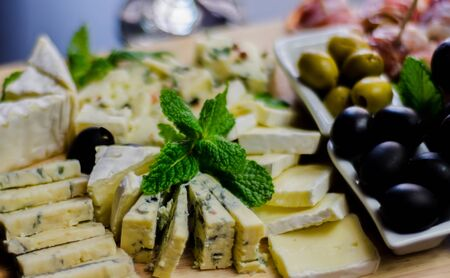 set of different cheeses on a wooden board, cheese board, delicious snack, healthy and exclusive food, cheese set 免版税图像