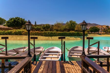 A beautiful place in a city park with water and moored white boats, a perfect place for a romantic time for couples and honeymooners, a unique location Stock Photo