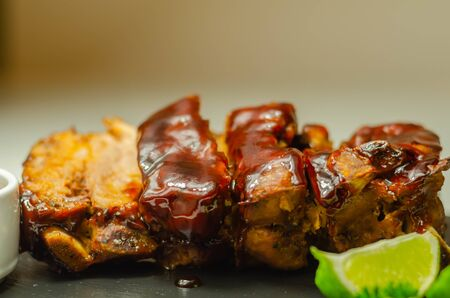 Pork ribs in a smoky flavour barbecue seasoning with a honey barbecue sauce, pork mini ribs
