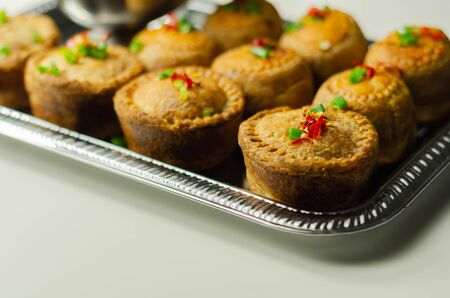 Traditional  English pork pies with cranberry sauce on a silver tray, English food Stock Photo