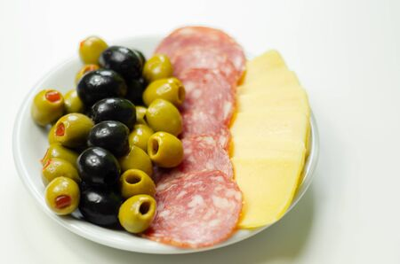 Set green and black olives with salami and cheddar cheese, starter