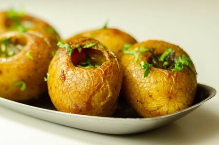 Mini jacket potatoes with a fragrant garlic butter infused with Italian truffle oil, delicious food 免版税图像
