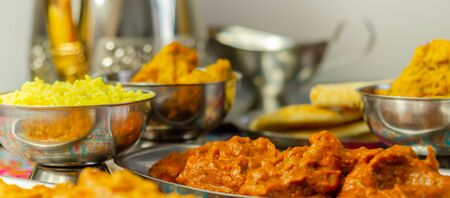 Chicken Madras and Chicken Tikka Masala with Pilau Rice, Naan Breads and, Onion Bhajis, a traditional Indian dish