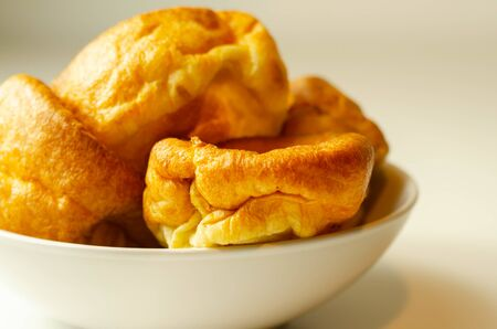 Traditional English Yorkshire pudding, wonderfully crisp and golden baked for a traditional recipe, accompaniment for the perfect Sunday roast, English food