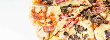Freshly baked large pizza with ham, mushrooms and mozzarella on a traditional dough, typical Italian dish