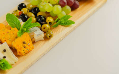 British hand-made and selected cheeses from local farms served on a wooden board, a unique set
