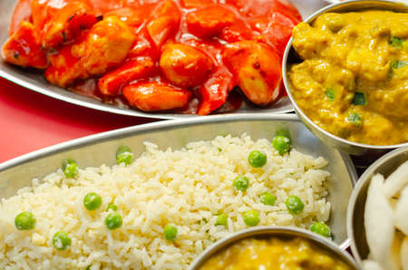 Chinese set,  chicken curry, sweet and sour chicken served with egg fried rice, vegetable spring rolls, and prawn crackers, china food