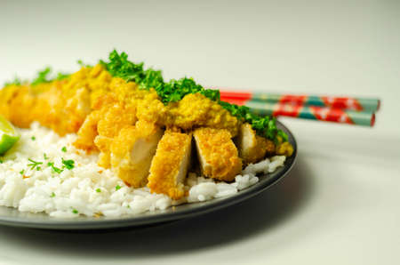 Crispy chicken perked up with an aromatic katsu curry sauce and fragrant fluffy rice, Japanese food