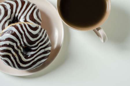 Doughnut with chocolate flavour filling, topped with white and black icing, donut named zebra Imagens