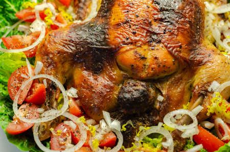 Roasted British large chicken with classic pork, sage, and onion stuffing served with little gem lettuce, tomato, and  fresh onion, delicious food Banque d'images