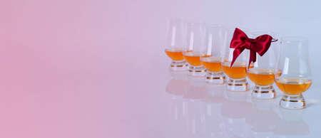 Set of single malt tasting glasses, single malt whisky in a glasses, red bow, exclusive set