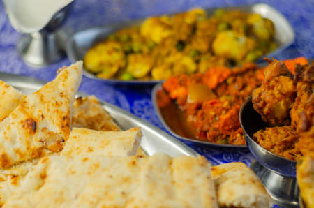 Chicken jalfrezi and chicken curry with various rice and onion Bhajis and Samosas, traditional Indian dish 版權商用圖片