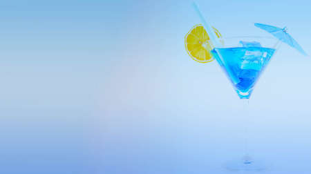 Blue cocktail in a martini glass with lemon and ice cubes, a refreshing alcoholic drink based on vodka and blue liqueur, party time