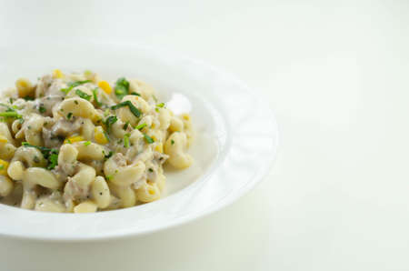 Cooked pasta with flaked tuna and sweetcorn in mayonnaise dressing, healthy salad