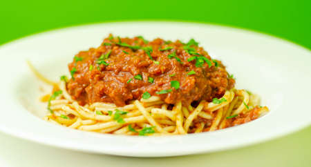 Minced beef bolognese with onions and carrots served with spaghetti, italian food