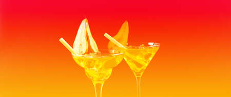 Green alcoholic drinks on the basis of pear with ice cubes prepared by the bartender,  the perfect party drinks