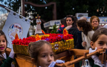 VELEZ-MALAGA, SPAIN, MARCH 24, 2018 Children participating in the procession associated with the holy week in a Spanish town