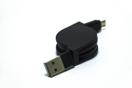 Black USB cord adapter on a white background